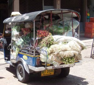A loaded tuk tuk